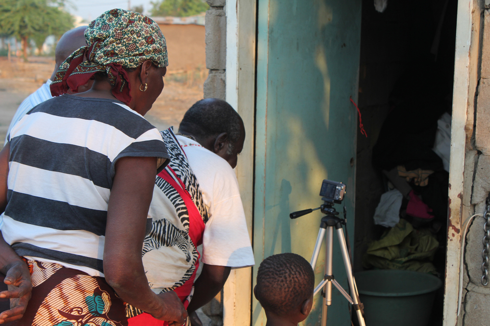 Setting up the camera for a shot, Chokwe, Mozambique  © Matt Daw 2012 / ODI / PhotoVoice
