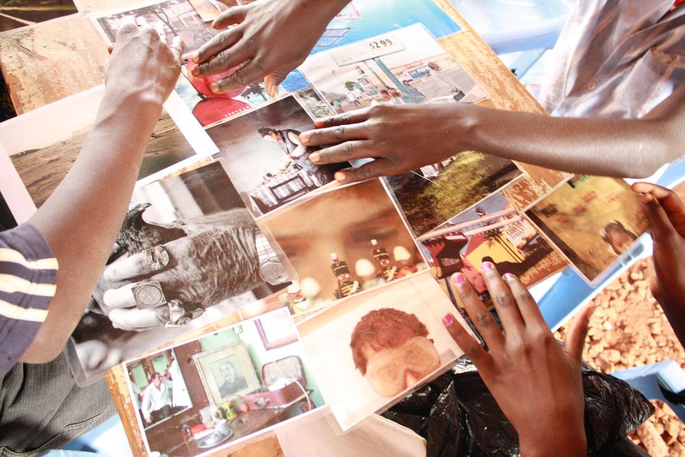 Participants carrying out a photo-sorting exercise, Kwakavisi, Kenya.  © Samuel Mbuto 2012 / ODI / PhotoVoice