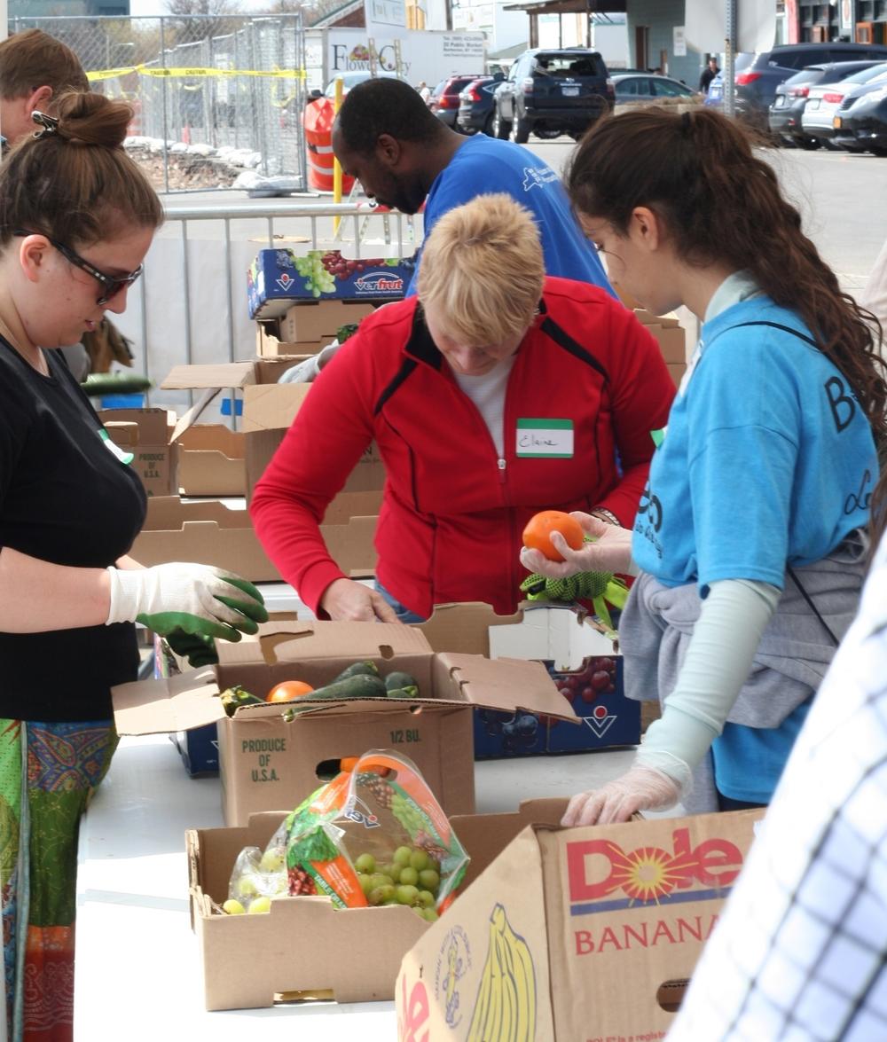 Flower City Pickers volunteers sort through refuse food on site. Photo: Brett Gobe