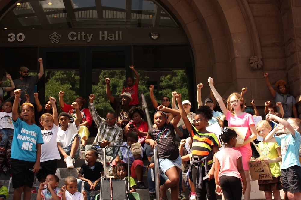 Dozens of youth and families gather on the steps of City Hall two days after 74 people were arrested at a peaceful Black Lives Matter rally.