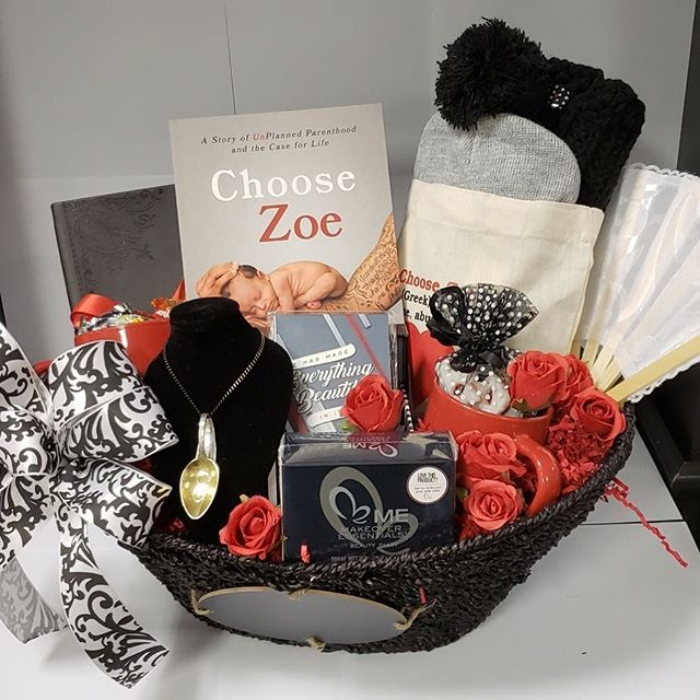 """GIVEAWAY TIME 🙌🏻💫 Who doesn't love a free gift basket? To celebrate the release of """"Choose Zoe: A Story of Unplanned Parenthood"""" we are giving away a free gift basket filled with a copy of the book and some more goodies! All you have to do is SHARE this photo and TAG us (make sure your post is set to PUBLIC so we can see)."""