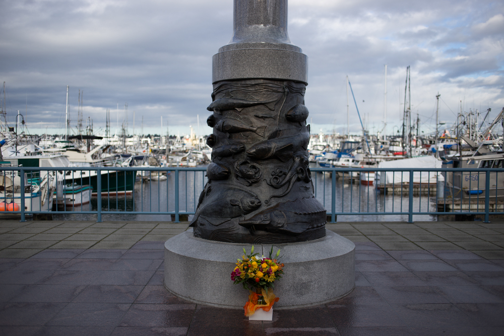 Fresh flowers are laid in front of the fisherman's memorial at Fishermen's terminal. The memorial is dedicated to Seattle fisherman that had lost their live at sea. Commercial Fishing is considered to be one of the most dangerous occupations in the world, with an average of 124 deaths per 100,000 workers compared to the 4 per 100,000 on average in the US.