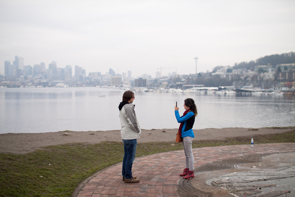 A couple takes a photograph at Gas Works Park, one of Seattle's most popular parks.