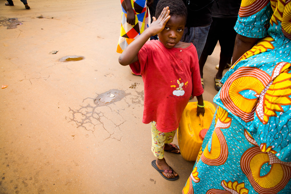 Jerrycan man. Freetown, Sierra Leone.