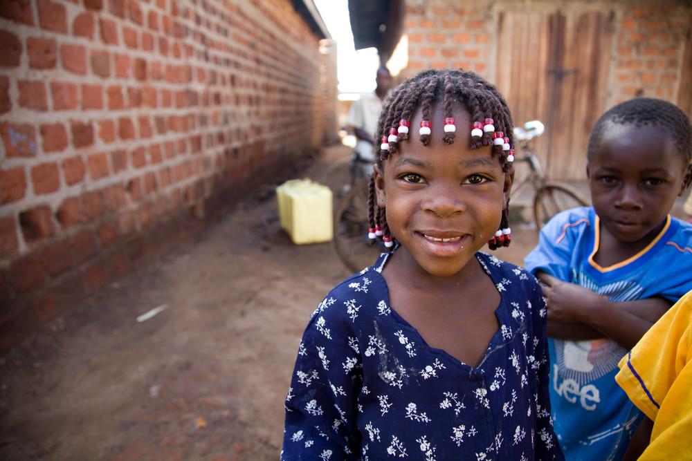 Braids with beads. Ssenyi, Uganda.