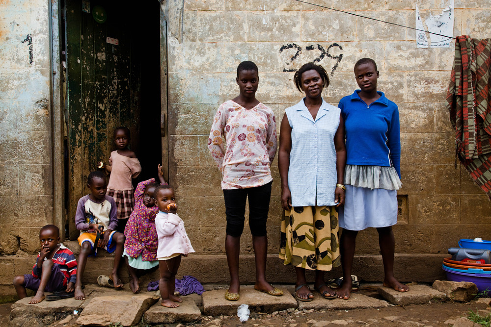 Portrait of a breakdancer and her family. Kampala, Uganda.