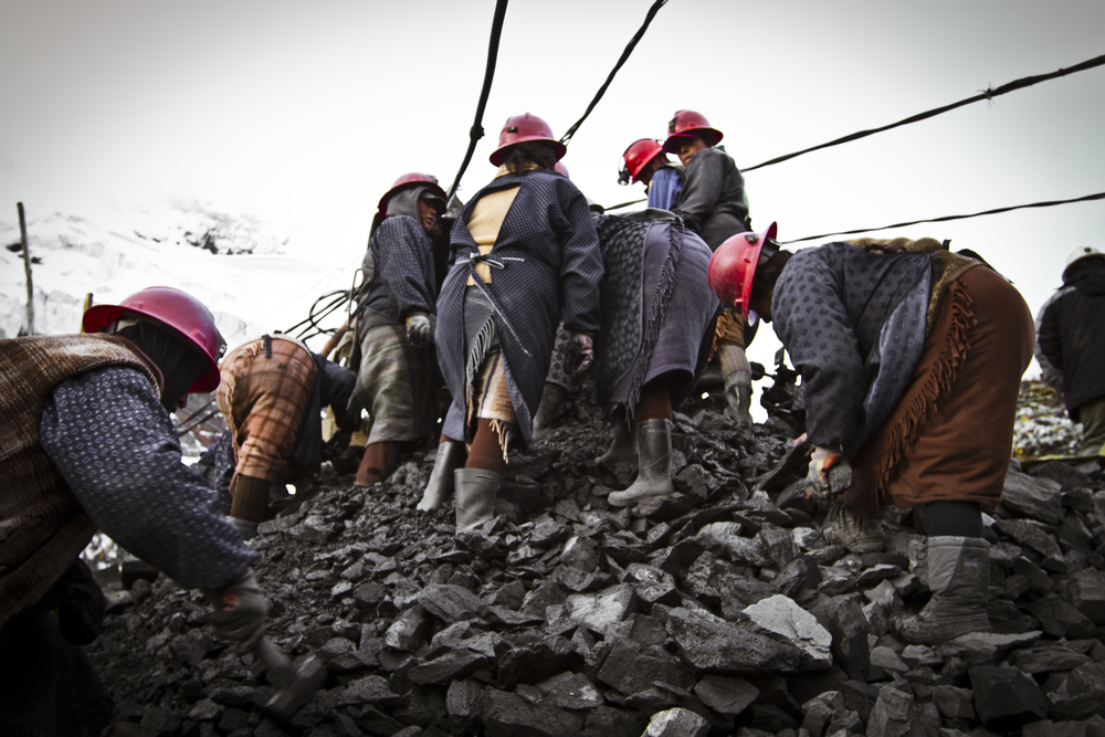 These women pound rock for a living. La Rinconada, Peru.