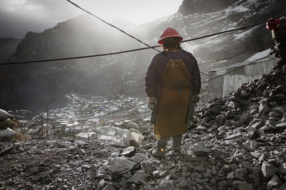 This woman pounds rock for a living. La Rindonada, Peru.