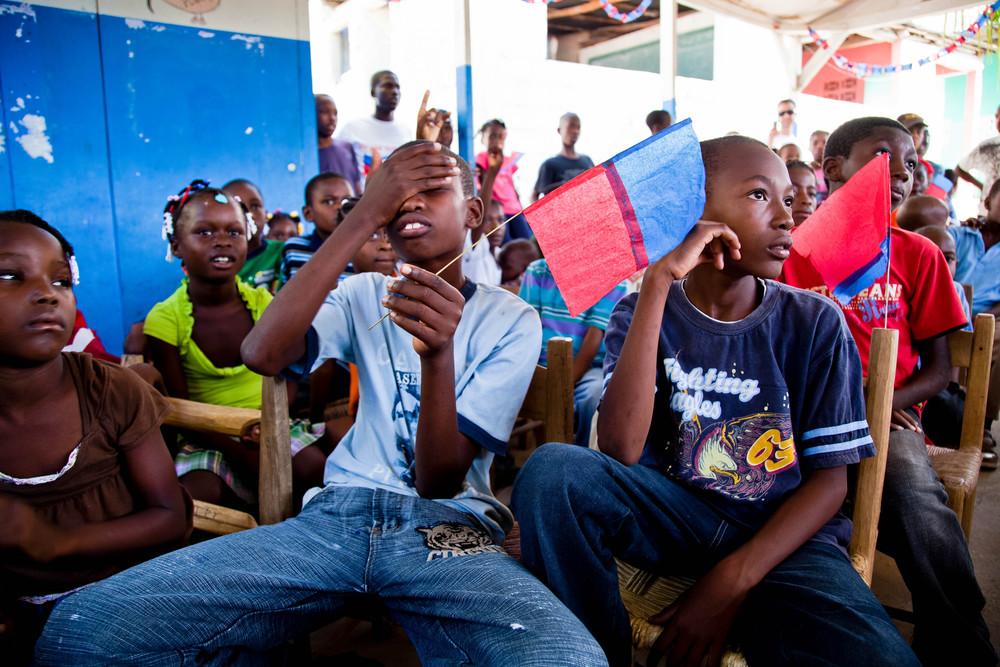 Camera shy on Flag Day. Port au Prince, Haiti.