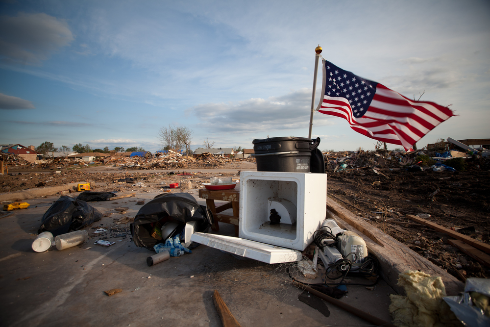 American flags dotted the scarred landscape and flew as symbols of resilience and strength.