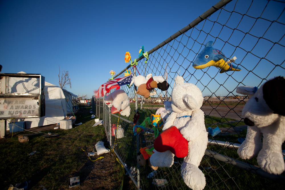 Stuffed animals hang on the gates where Plaza Towers Elementary once stood, in memoriam to the seven children who perished here.