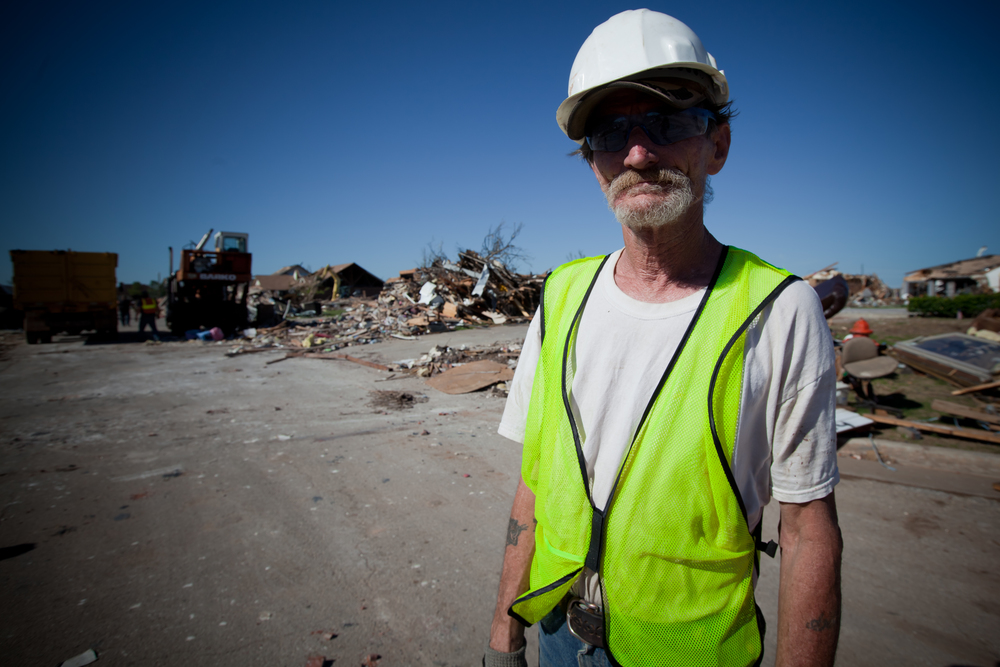 Victor, contract worker hired to clear debris. Victor resides in nearby Shawnee, Oklahoma, which was also affected by the May tornados. Rural Shawnee has not received the same level of relief attention and aid as neighboring Moore.