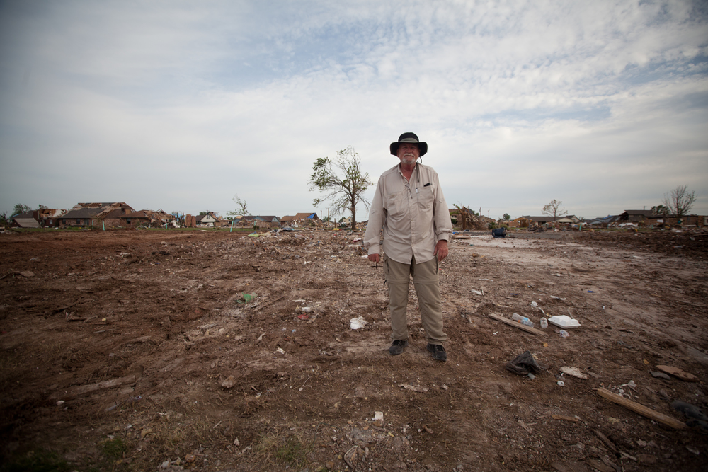 Frank, in front of his tree. Debris removal now complete, Frank takes one last look around the property where he raised his family. Longtime resident, Frank does not plan to rebuild in Moore.