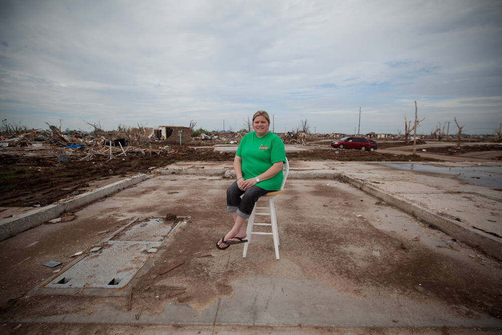 Nicole Jones sits near the storm cellar in the home where she and her teenage daughter once rented rooms. Like many in Moore, Nicole did not have renters insurance and is now in the process of filing for FEMA benefits.