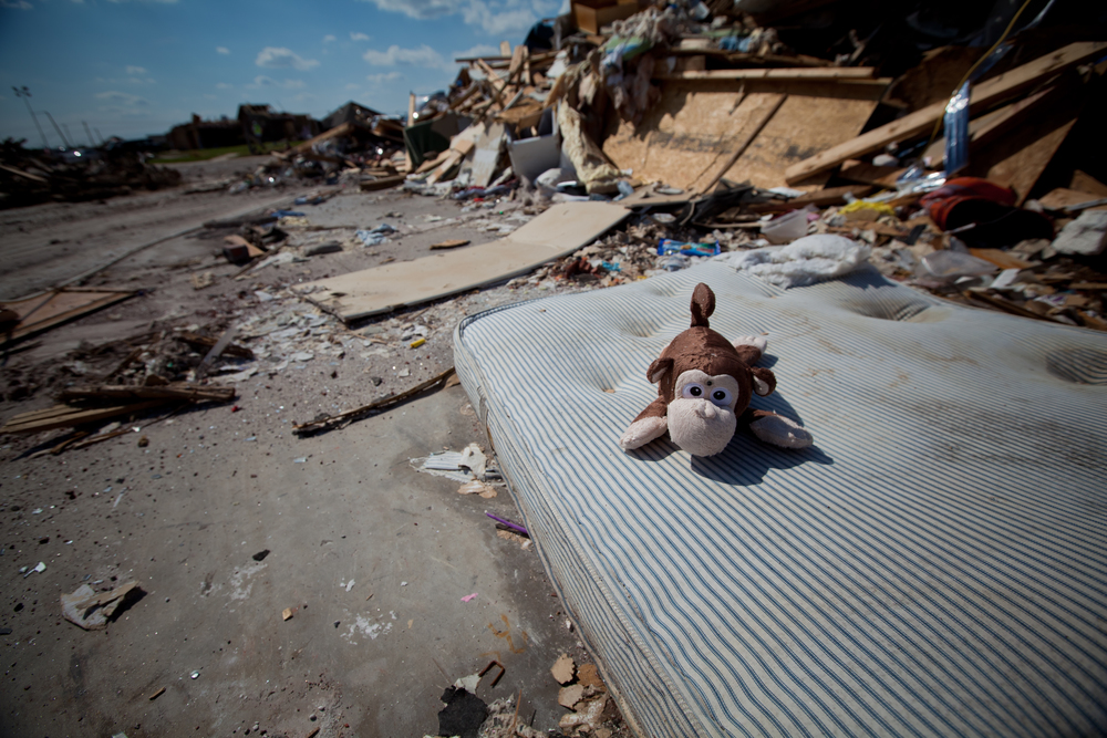 The monkey left behind, still smiles. Scattered stuffed animals remind of some of Moore's younger victims.