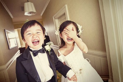 Happy little bride and groom