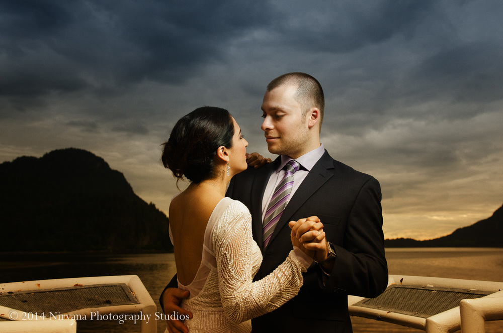 Maria and Angelo gazing into each other's eyes at Whytecliff Park.