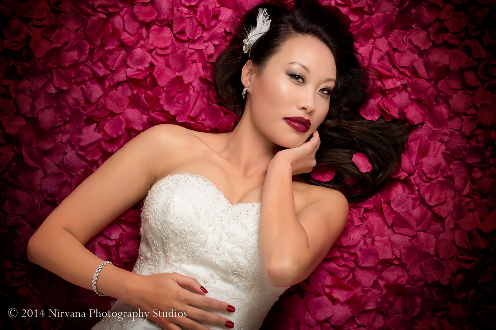 Beautiful bride on a bed of roses. Shot at our Gastown Studio. Click to enlarge.