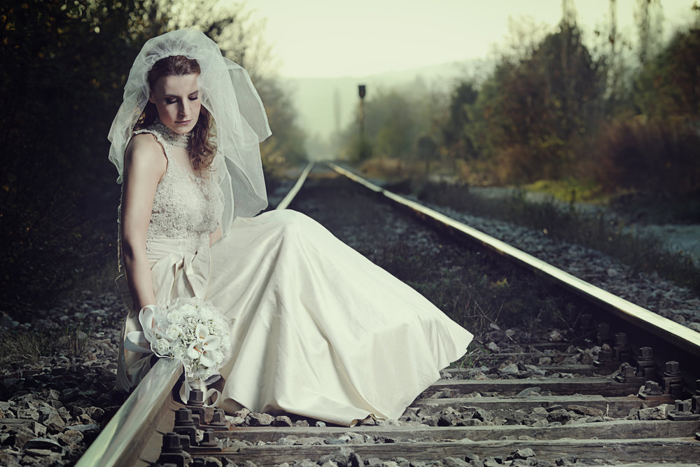 A view of a disappointed bride on a railway