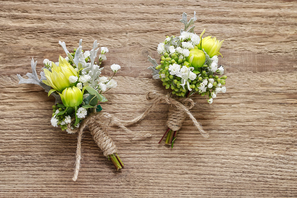 Wearing a boutonniere the right way makes the difference between looking like a movie start or someone who doesn't know what he is doing