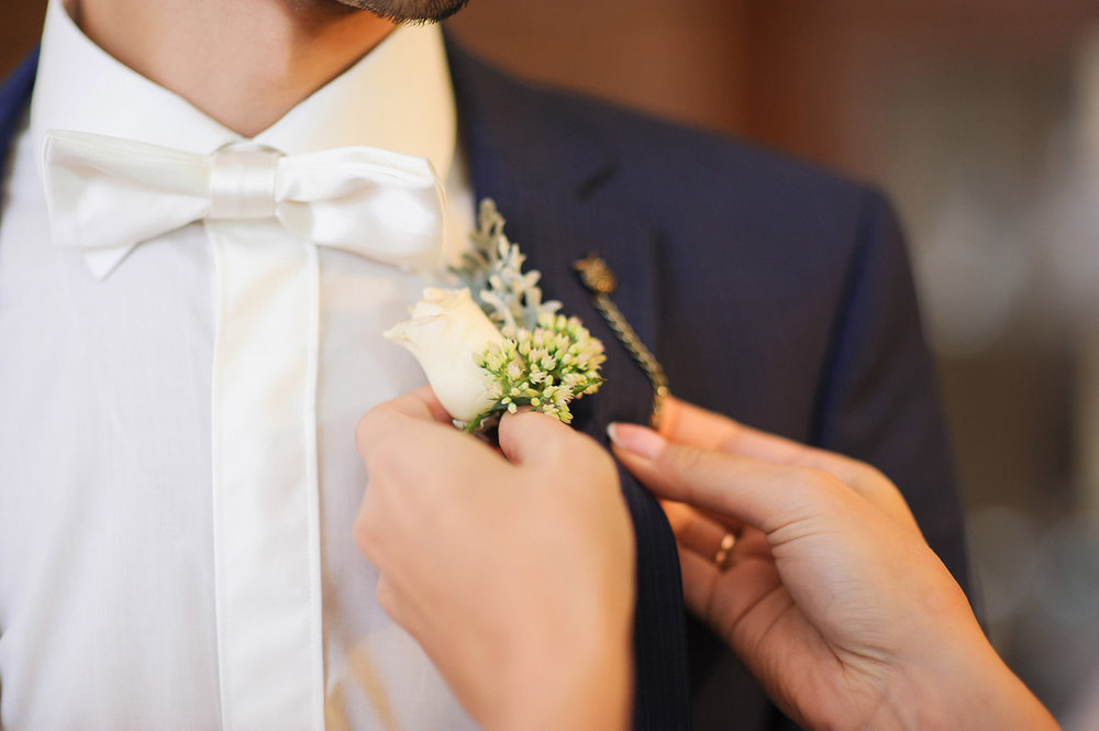 Pinning a boutonniere - the right way