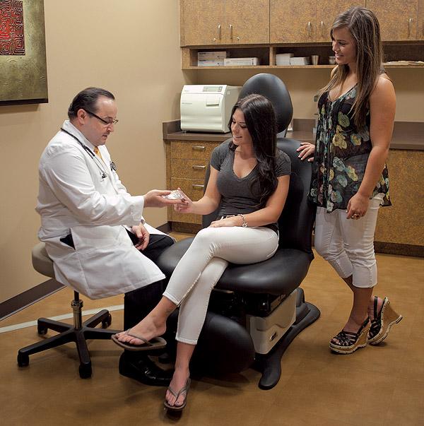 Dr. Aldo Guerra discussing breast implants in Scottsdale, Arizona