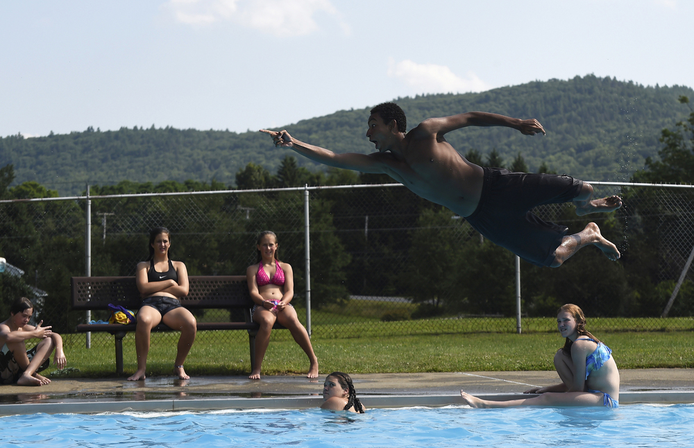 Alex Tyson of Vernon, Vt. flies through the air after doing a flip off of the diving board at the Vernon pool on July 22, 2014.