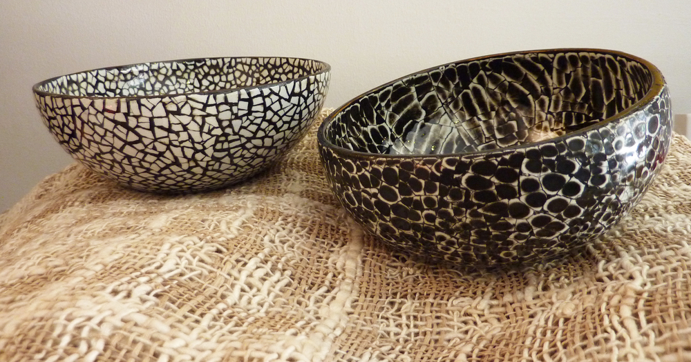 White Eggshell and Black Eggshell cocobowls resting on a Lotus Silk Burmese shawl