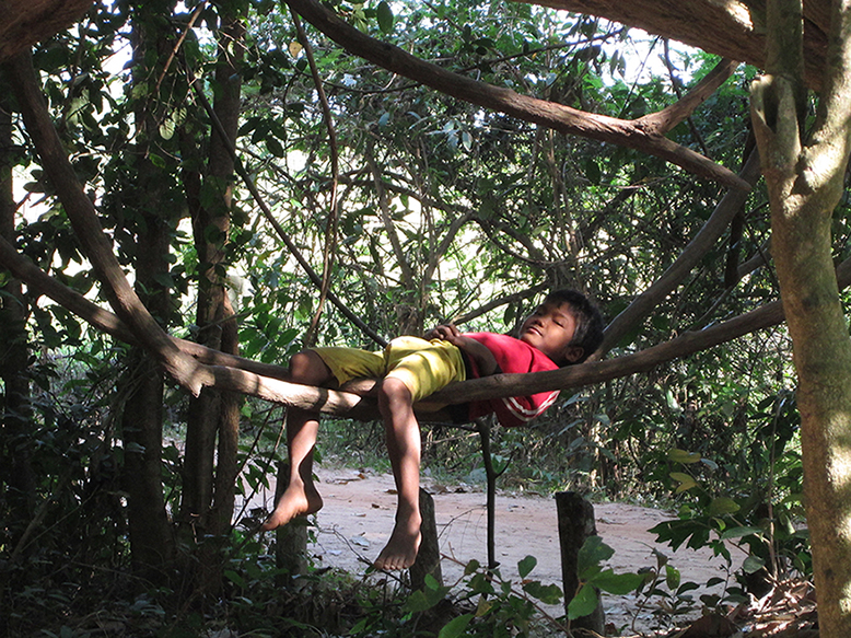 Boy relaxing with nature near Banteay Srei temple