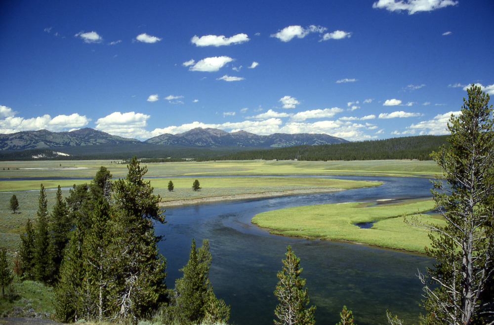 """Yellowstone River in Hayden Valley"" by Ed Austin/Herb Jones - http://www.nps.gov/archive/yell/slidefile/water/creeksstreamsrivers/yellrdbelowlake/Images/13240.jpg. Licensed under Public Domain via  Wikimedia Commons"