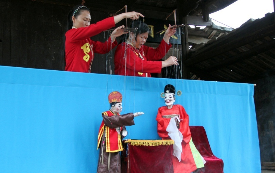 a puppet show on the village stage