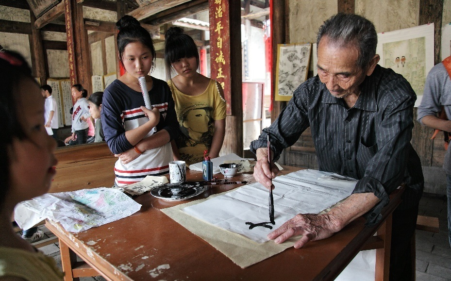 practicing calligraphy in a village hall
