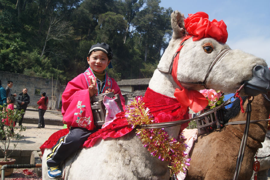 a child riding in the parade