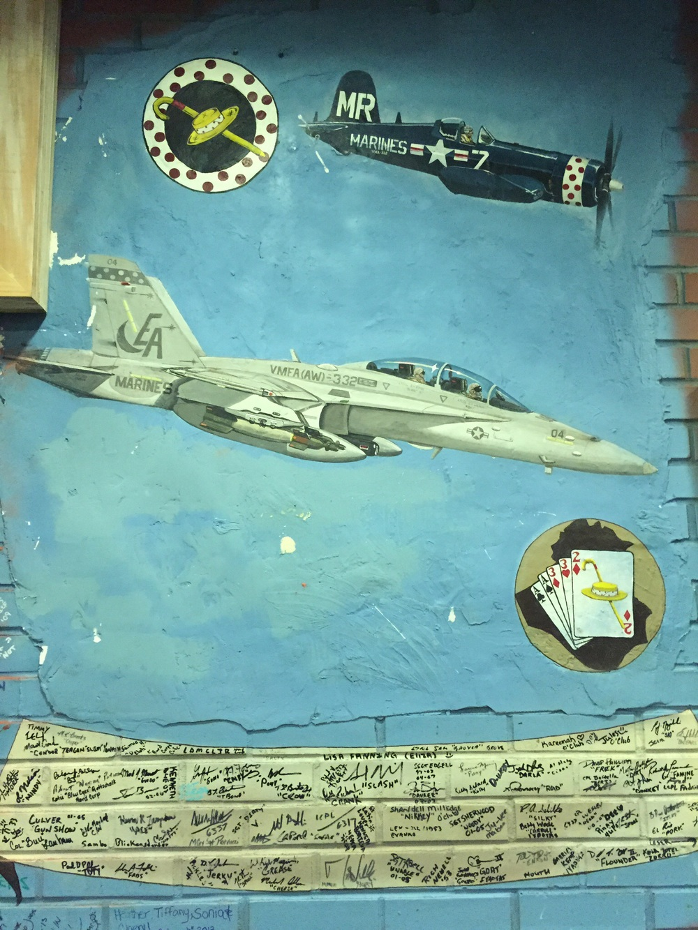 This image is from the wall of a bar at a Marine Air Base