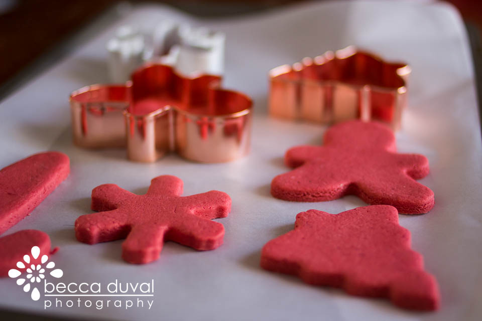 Once you cut out your shapes, move them onto a wax paper-ed cookie sheet.