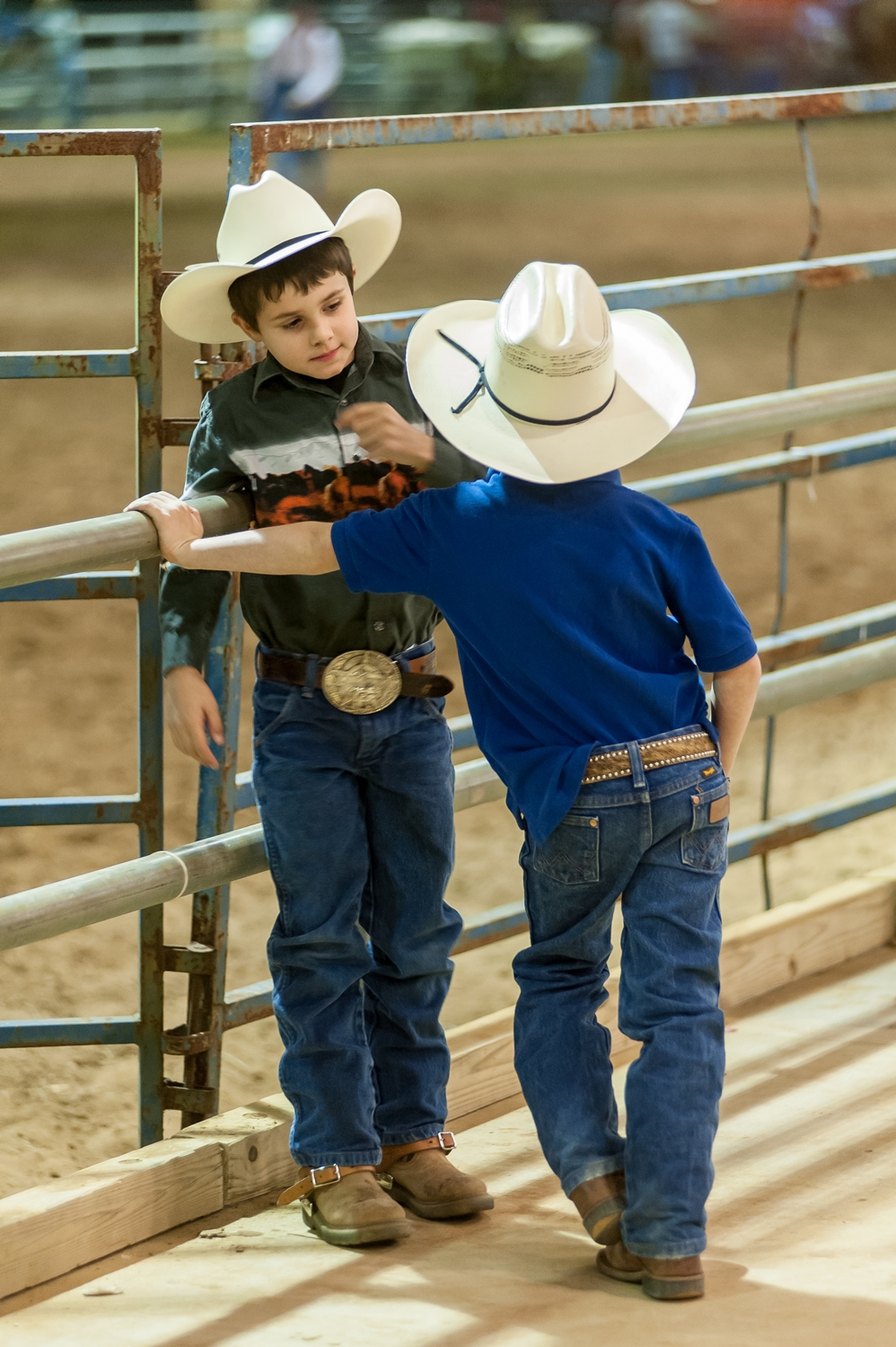 Two young cowpokes discuss the day's events at the St. Johns County Rodeo.