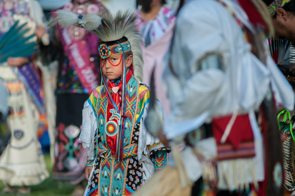 The Kaw Nation held a pow wow on their sacred historical site in Council Grove, KS. Six year old Payton Roberts checks out some of the other dancers in the circle. He was VERY serious about his dancing.