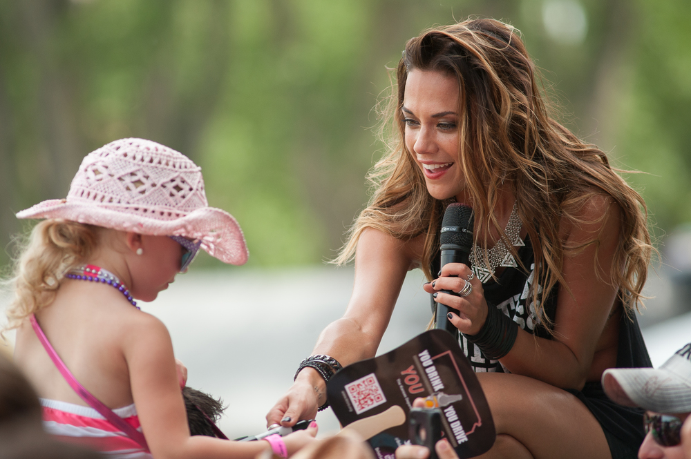 Country singer Jana Kramer gets up close and personal with a young fan on the last day of the Kicking Country Stampede music festival on Sunday afternoon.