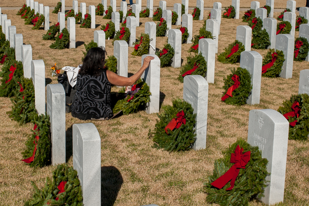 After the volunteers and crowds have left Jacksonville National Cemetery on Saturday, Vivian Jantzen spends some time alone at the grave of her husband, Senior Chief Ross Jantzen who passed away in 2012. Wreaths Across America is a national event where Christmas wreaths are laid on the grave sites of veterans in veteran cemeteries across the country.