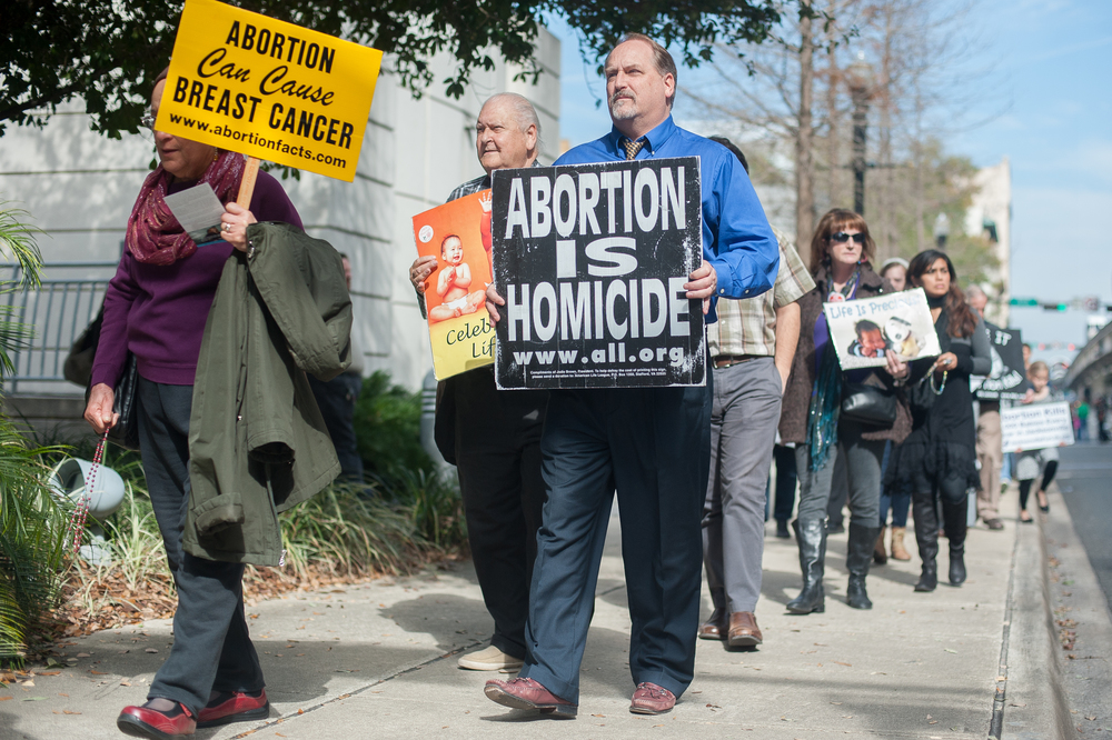 On the anniversary of the Roe v. Wade decision, hundreds of demonstrators opposed to abortion participate in the annual March For Life around the Bryan Simpson Federal Courthouse in downtown Jacksonville.