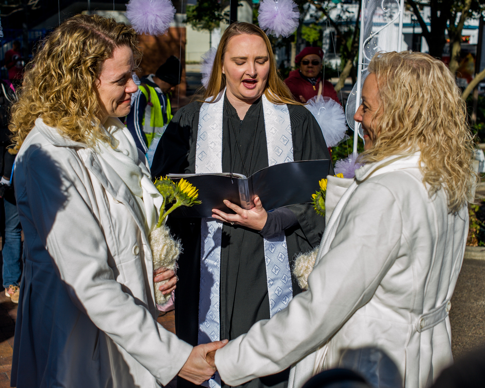 In light of the recent Supreme Court decision to allow same sex marriages in the State of Florida, thirty-four couples celebrated their weddings in Hemming Park in downtown Jacksonville on Saturday morning, the first day that they could legally wed after getting their marriage licenses on Tuesday.