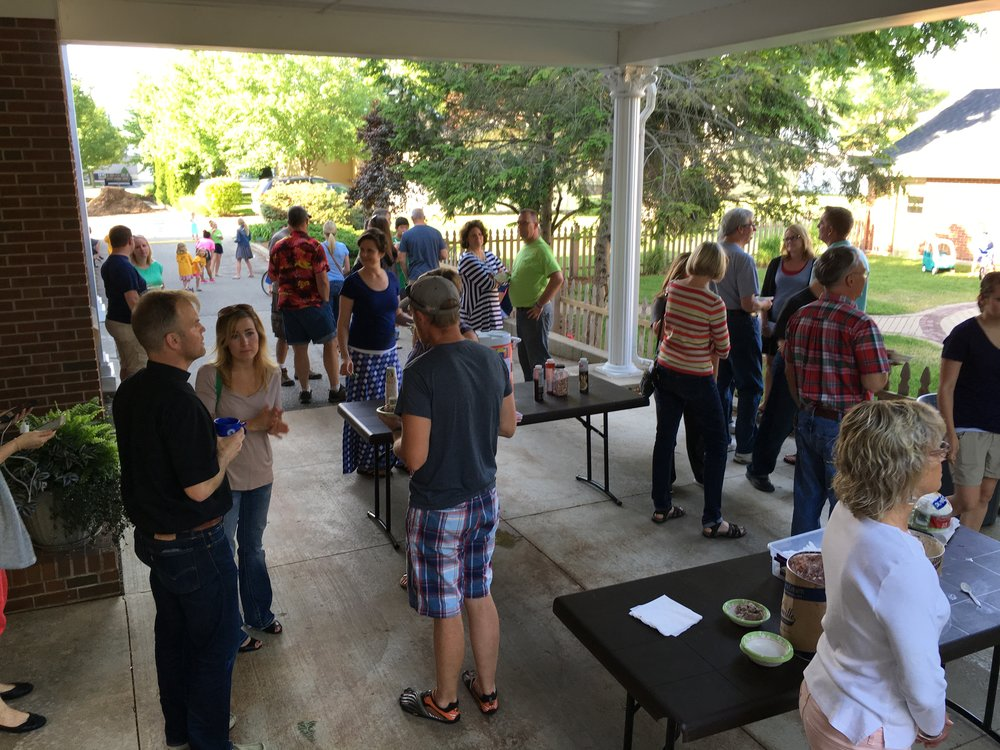 "Ice cream sundaes being enjoyed outside after ""Sundays on Wednesdays"" worship"
