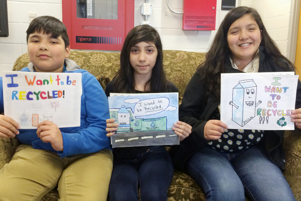 Dalton Middle School students that placed in the billboard contest are pictured with their artwork.  From Left to Right: Leonardo Fraire, Yanira Guzman, and Alondra Martinez.