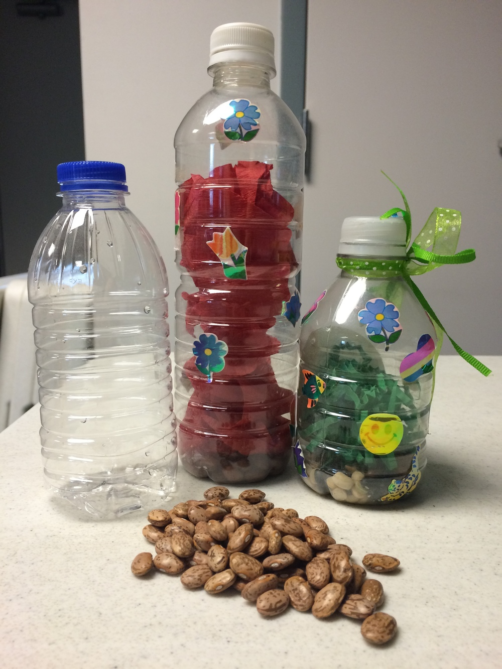 Make your own music shakers or maracas with materials typically found in recycling bins, like the plastic bottles pictured above.
