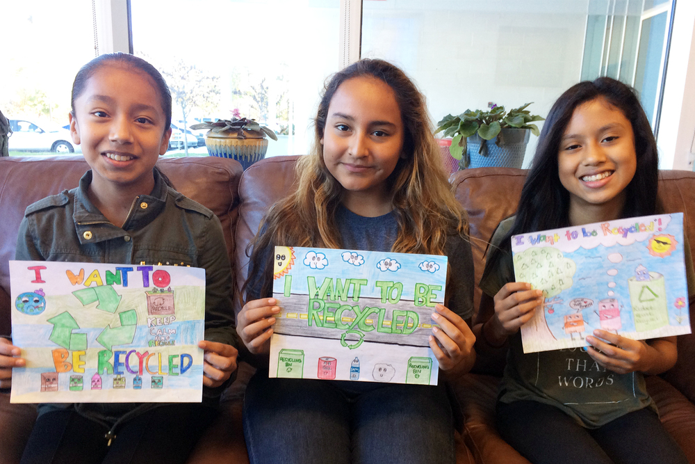 Eastbrook Middle School 7th grade students who placed in the billboard contest are pictured with their artwork. Left to Right: Montserrat Adame, Elena Cabreo, and Emily Ruiz.