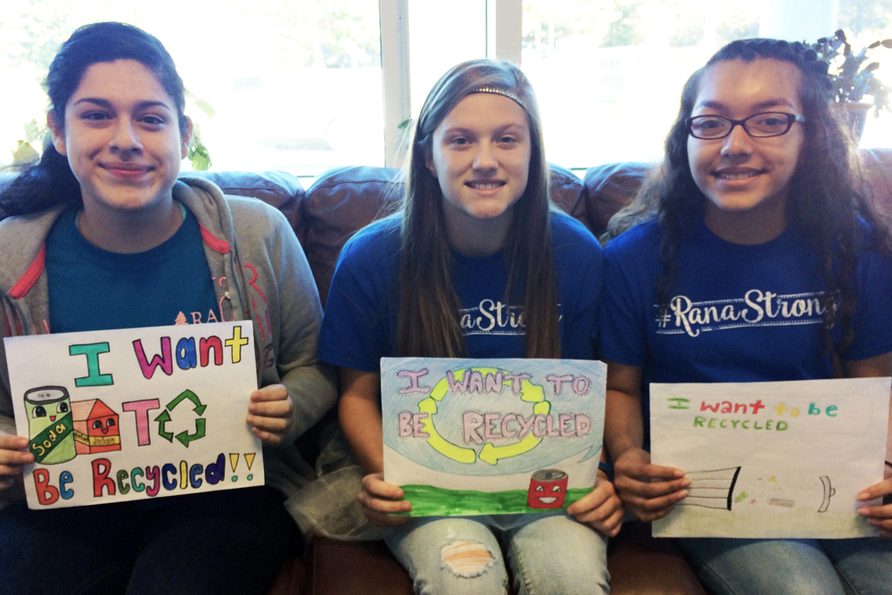 Eastbrook Middle School 8th grade students who placed in the billboard contest are pictured with their artwork. Left to Right: Reina Paniagua, Stephanie Sullivan, and Denise Hernandez.