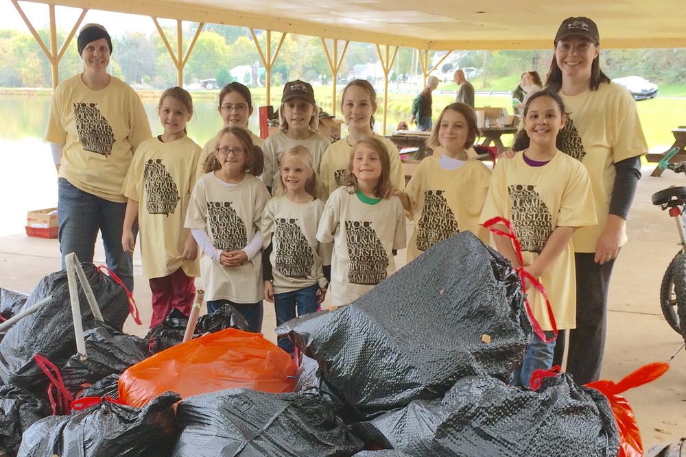 Girl Scout Troop 14603 at Lakeshore Park in Dalton where volunteers helped to remove more than a ton of garbage during the 2015 river cleanup.