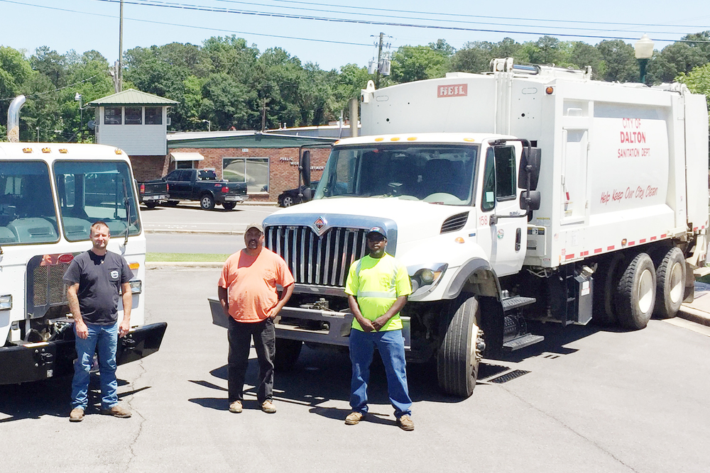 Pictured are City of Dalton garbage collectors from the public works department. From left: K.T. Toliver, Quinton Dupree, and Shane Stepp. (Not pictured is Shane Jordan.)