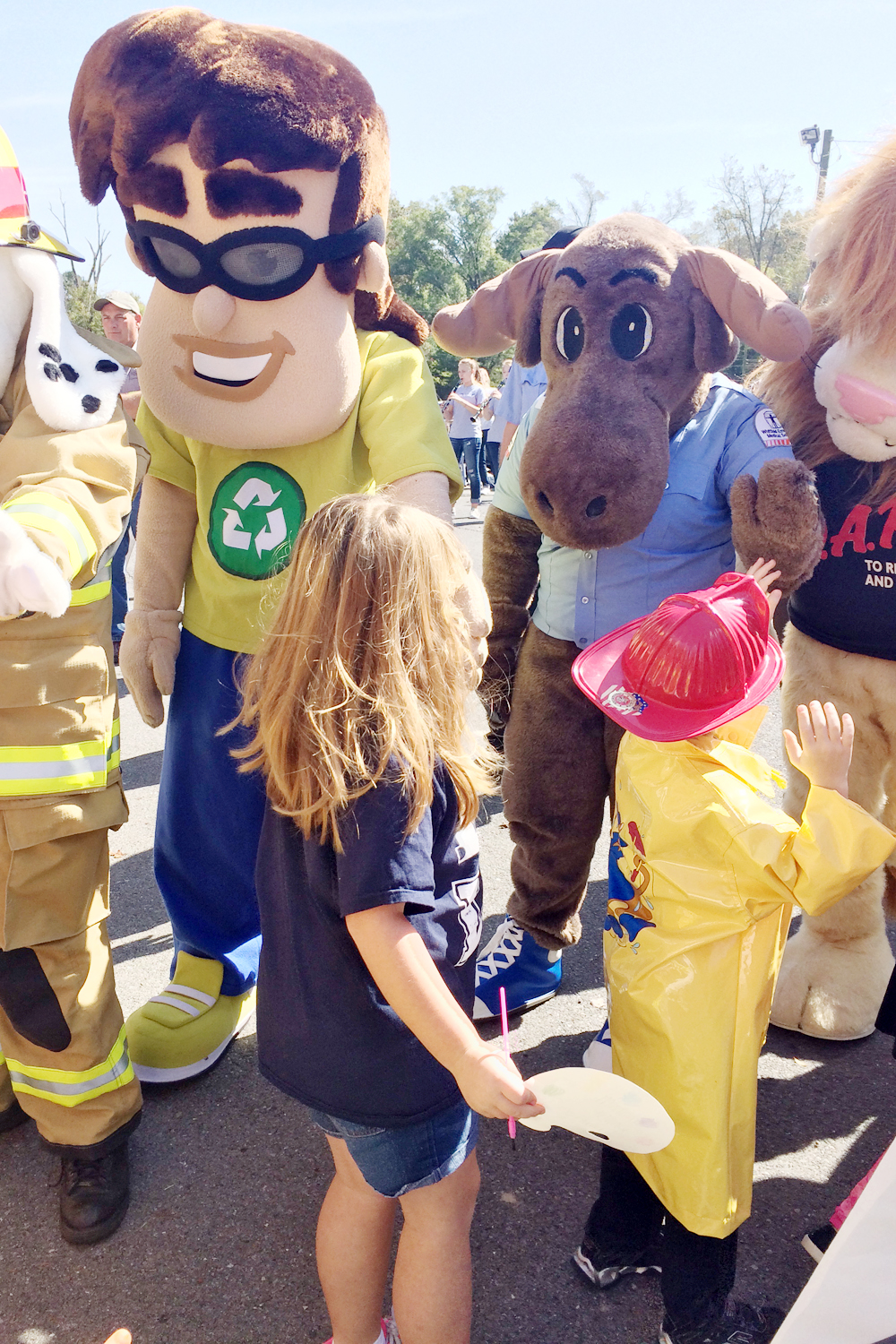 Mascot Recycling Ben greets students along with Medic Moose (Official Mascot of Hamilton EMS) and other mascots during the annual Cohutta Elementary School Career Day and Parade. An appearance by Recycling Ben is one of the benefits of Target Recycling at School.