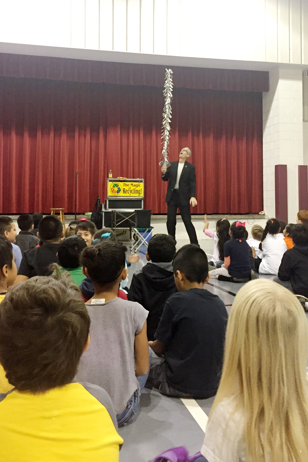 Students look on as a rolled-up newspaper magically transforms back into a tree during the Magic of Recycling show with magician Greg Allen. The program was hosted at Pleasant Grove Elementary and six other local schools during the week of November 7.